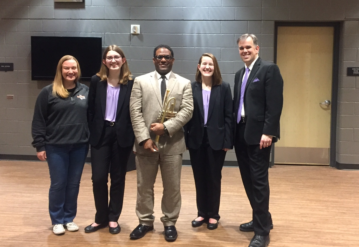 Marcus Printup is photographed with students and staff following a collage concert on March 11, 2020.
